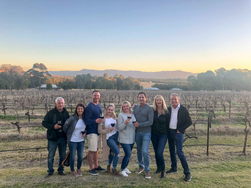 Group at Sunset at Blue Berry Hill with the grapevines